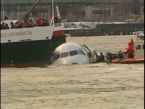 """miracle on the hudson plane- us airways flight 1549 is in the hudson river after miraculous landing by pilot chesley """"sully"""" sullenberger. the plane... - river hudson stock videos & royalty-free footage"""
