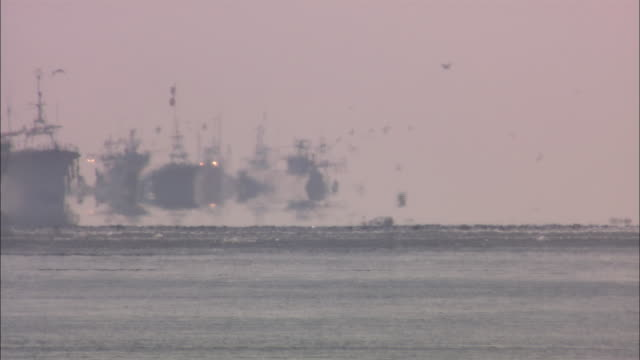 mirage and the sukeso fishing boat in hokkaido - heat haze stock videos & royalty-free footage