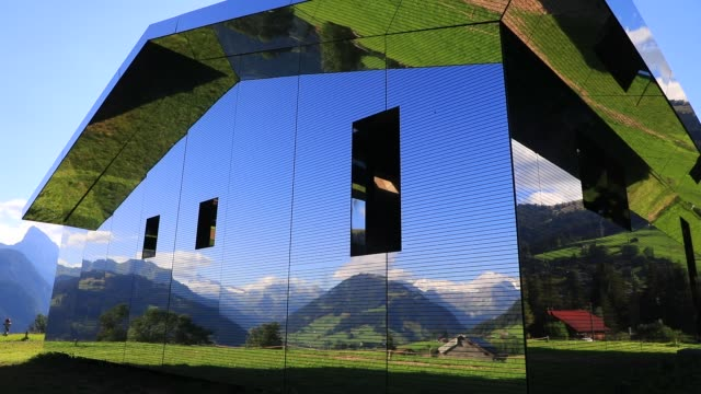 mirage gstaad by los angelesbased artist doug aitken is on display outside as installation sculpture representing a chalet made with mirrors... - ski resort stock videos & royalty-free footage
