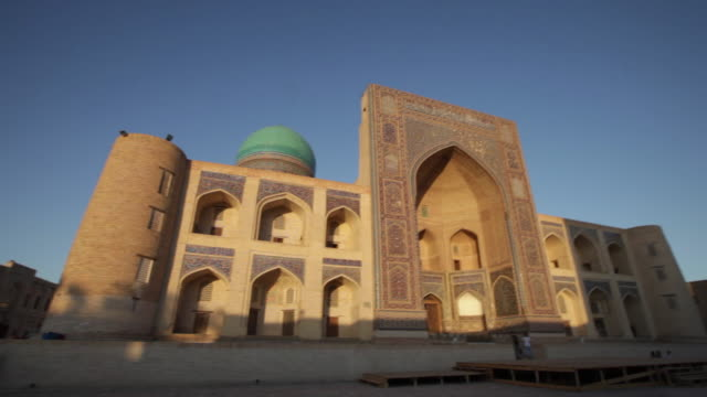 mir-i arab madrassah in bukhara at sunset, uzbekistan - bukhara stock videos and b-roll footage