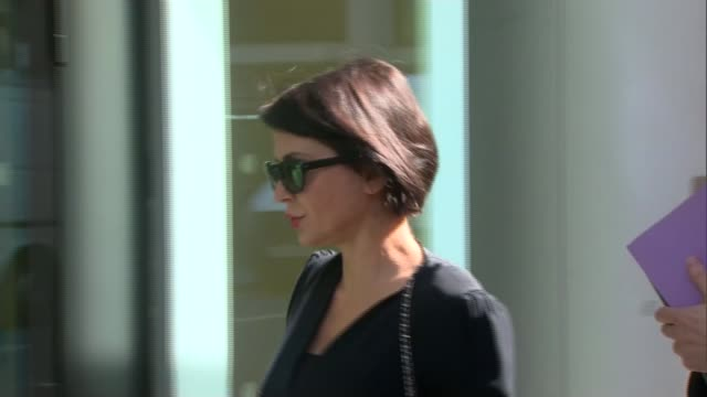 Judge awards record damages ENGLAND London Royal Courts of Justice Sadie Frost along and into court with unidentified woman/ Shobna Gulati speaking...