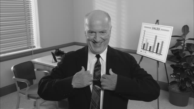 See other clips from this shoot 1037 videos and b roll footage bw ms mirror point of view of happy businessman straightening shirt and tie as ccuart Gallery
