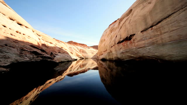 ms pov mirror reflections in water of lake  showing dropping change in climate / arizona,united states - lago powell video stock e b–roll