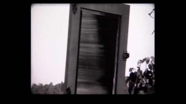 vídeos de stock, filmes e b-roll de 1968 mirror swings from branch, then breaks, experimental - surreal