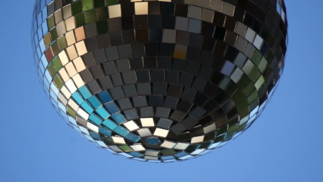 mirrorball spins around against a blue sky - mirror ball stock videos & royalty-free footage