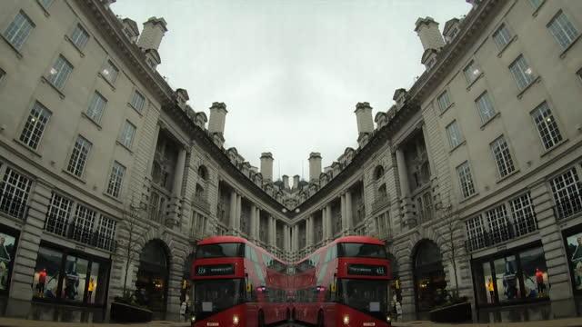 mirrored pov down london street - arch stock videos & royalty-free footage