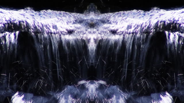 mirrored water flows over rocks. - digital enhancement stock videos & royalty-free footage