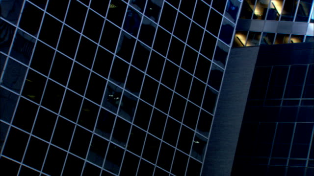 Mirrored windows cover the exteriors of office buildings in downtown Chicago. Available in HD.