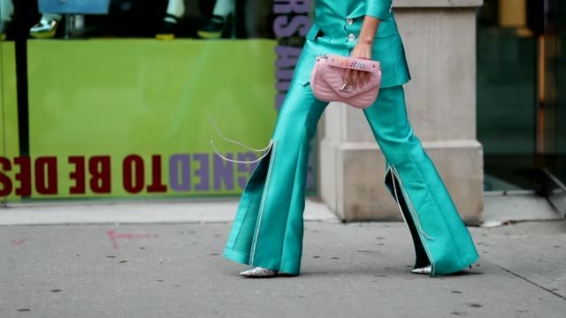 stockvideo's en b-roll-footage met miryam labiad wearing blue suit by chaenewyork louis vuitton bag earring solomeina jewelry is seen during new york fashion week spring/summer 2019 on... - zakelijke kleding