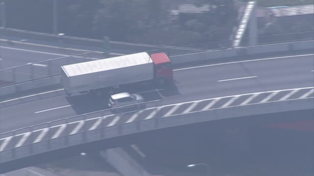 aerial, misato junction on expressways, saitama, japan - トラック点の映像素材/bロール