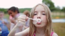 Mischievous Girl Blowing Bubbles
