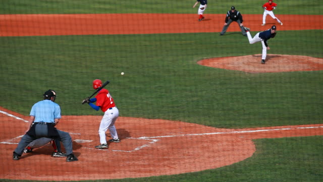mishap at baseball junior match - baseballmannschaft stock-videos und b-roll-filmmaterial