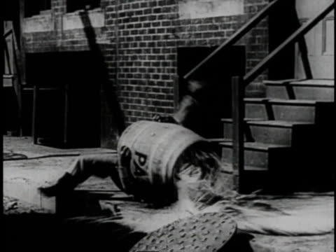 1920 montage mishaps ensuing after armed restaurant owner chases man and woman  - larry semon stock videos and b-roll footage