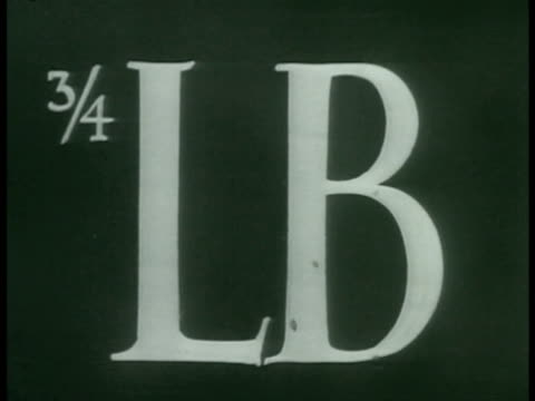 stockvideo's en b-roll-footage met misleading signs for food gas. weighing peas to verify label weight. checking chocolate candy oversized box. cutting loaf of french bread. - 1933