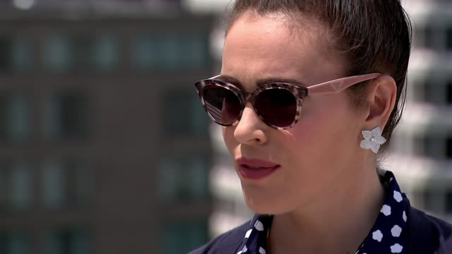 organisers scrap swimsuit competition usa ext alyssa milano interview sot - alyssa milano stock videos & royalty-free footage