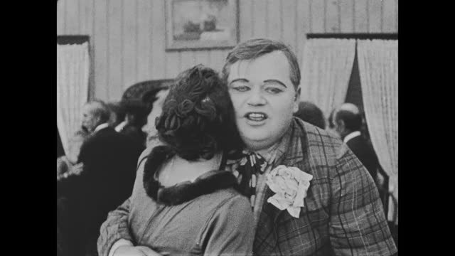 1918 miss cutie cuticle (alice lake) stands on man's (fatty arbuckle) feet as they dance - fatty arbuckle stock videos and b-roll footage