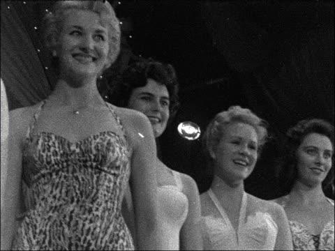 stockvideo's en b-roll-footage met miss england contest at the lyceum ballroom; england: london: lyceum: various shots miss england contestants parading judges miss england girls lined... - spelkandidaat