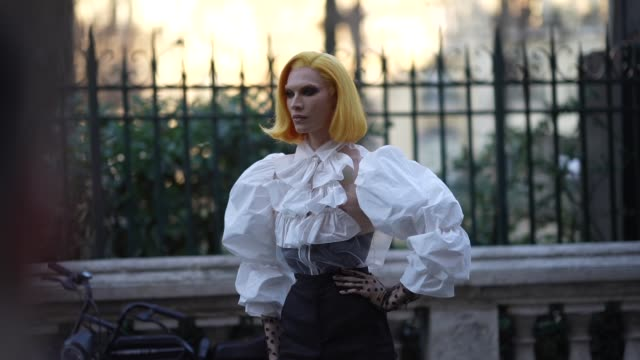 stockvideo's en b-roll-footage met miss fame wears a white mesh ruffled top with puff sleeves black pants mesh gloves pointy shoes outside viktor rolf during paris fashion week haute... - gepunt