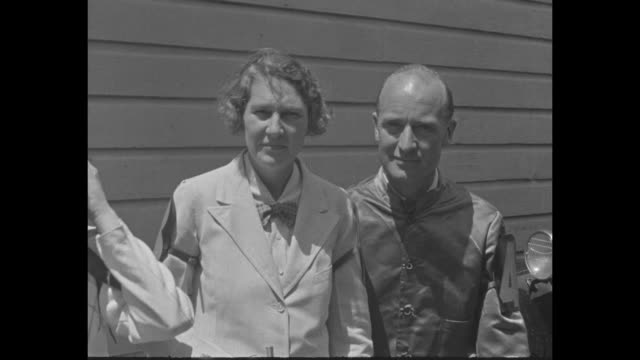 VS Miss Frances Post wearing white and holding whip with E R Harriman and Gladys Harriman both dressed in racing togs / rider a male member of the...