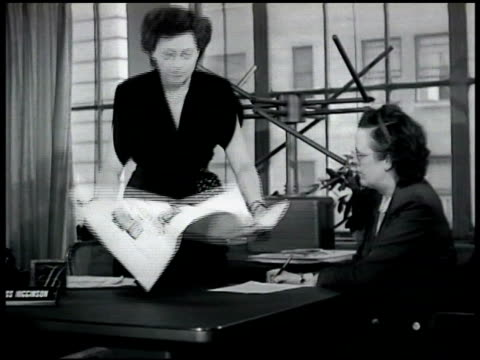 miss harriet higginson, general manager, rca consumer custom products div' executive woman placing newspaper page on office desk in front of another... - rca stock videos & royalty-free footage