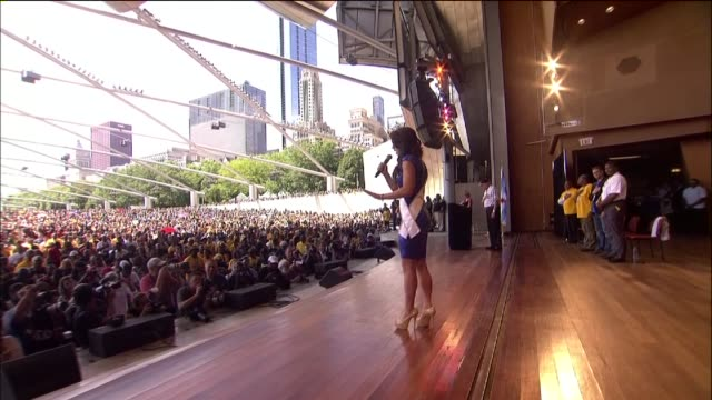 wgn miss illinois 2014 marisa buchheit sings the national anthem at the jackie robinson west little league team celebration in millennium park on... - youth baseball and softball league stock videos and b-roll footage