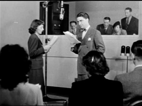 vídeos y material grabado en eventos de stock de miss johnson' reading w/ paul crabtree from 'claudia' script w/ rose franken & others in booth bg, two seated female actors/actresses w/ scripts.... - guionista