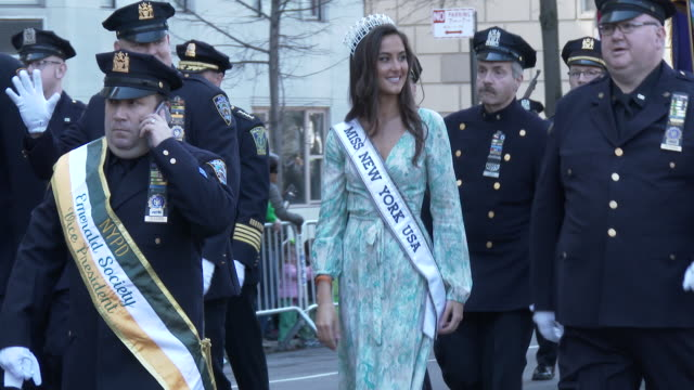 Miss New York USA marches with NYPD Officers in the 2016 St Patrick's Day Parade on 5th Avenue in Manhattan