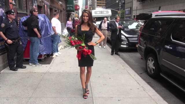 miss usa 2014 nia sanchez exits the late show with david letterman and poses for photographers in celebrity sightings in new york, - nia sanchez stock videos & royalty-free footage
