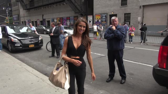 miss usa 2014 nia sanchez poses for photographers before going into the late show with david letterman in celebrity sightings in new york, - nia sanchez stock videos & royalty-free footage