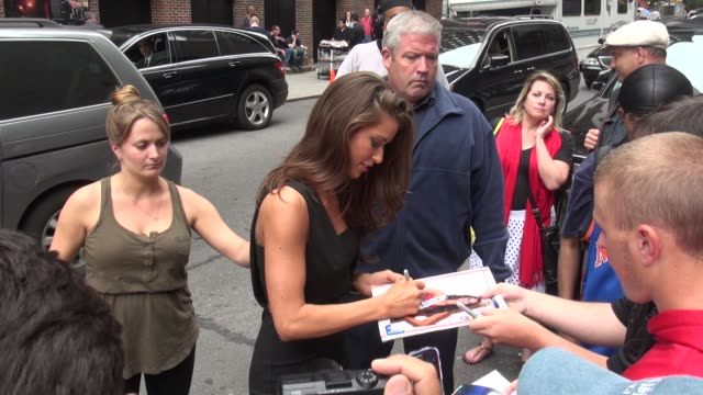 miss usa 2014 nia sanchez signs for fans outside of the late show with david letterman in celebrity sightings in new york, - nia sanchez stock videos & royalty-free footage