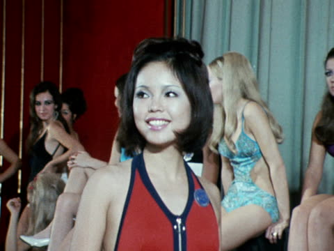 miss world contestant poses in a swimsuit at a photocall for the competition at the empire ballroom. november 1970. - miss world pageant stock videos & royalty-free footage