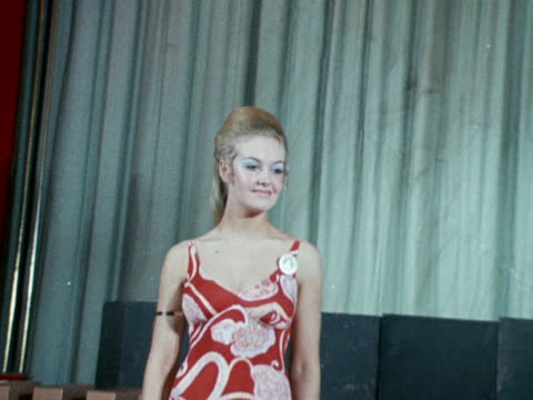 a miss world contestant poses in a swimsuit at a photocall for the competition at the empire ballroom november 1970 - beauty contest stock videos & royalty-free footage