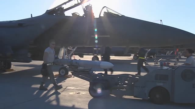 A missile is unloaded from an F15E assigned to the 494th Fighter Squadron 48th Fighter Wing at RAF Lakenheath England during Red Flag 143 Jul 21 2014...