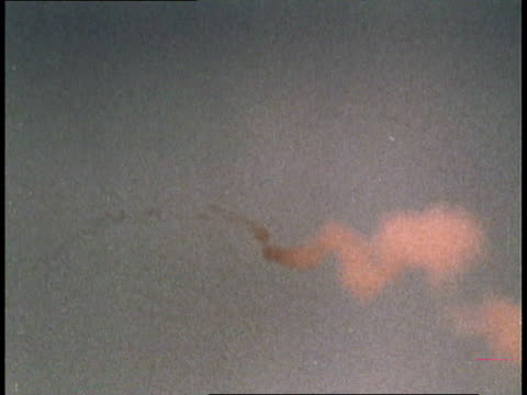 missile launching / missile flying through clouds / missile striking airplane and exploding - 1966 bildbanksvideor och videomaterial från bakom kulisserna