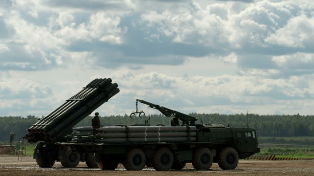 missile loading on heavy multiple rocket launcher - russia stock videos and b-roll footage