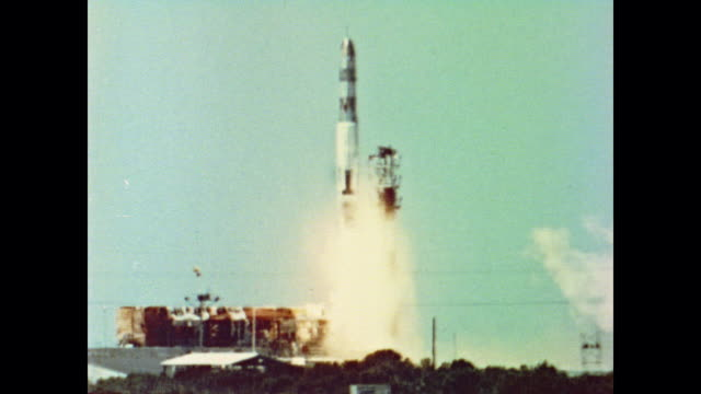 a missile rocket takes off from the launchpad as the voice over explains how missiles are necessary to save america from communism - anno 1962 video stock e b–roll