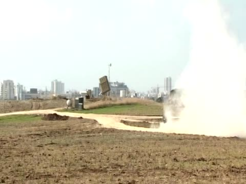 missiles are fired from israel's iron dome to intercept palestinian missiles - intercepting stock videos and b-roll footage