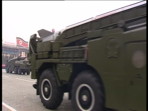 missiles are transported in a military parade watched by kim jongun and kim jongil pyongyang - 北朝鮮点の映像素材/bロール