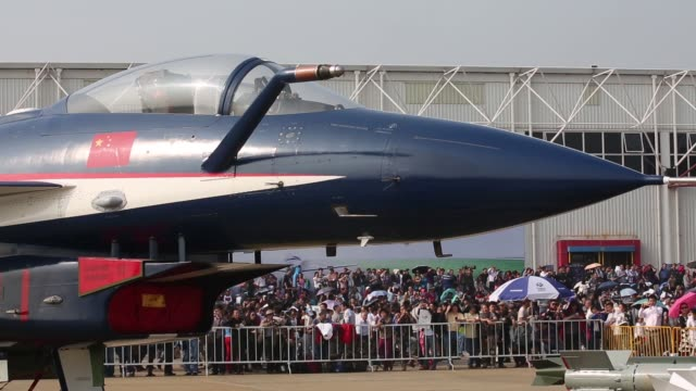 Missiles stand on display next to a People's Liberation Army Air Force Chengdu J10 jet fighter manufactured by Chengdu Aerospace corp a unit of...