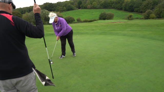 missing a short putt and then getting it in. - sun visor stock videos and b-roll footage