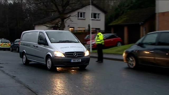 body found / neighbours attend church service SCOTLAND Fife Kirkcaldy EXT Private ambulance along road Various shots of cordonned off house and...