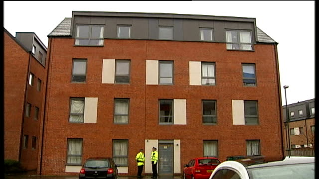 body found / neighbours attend church service Edinburgh Block of flats where Mikaeel Kular went missing TILT DOWN two police officers Woman looking...