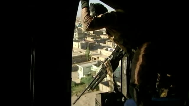 Missing British soldier found dead of gunshot wounds AIR VIEW / AERIAL of Kabul General view and close view of soldier hanging out of helicopter with...
