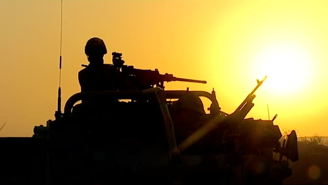 stockvideo's en b-roll-footage met missing british soldier found dead of gunshot wounds date silhouette of soldier with gun on humvee at sunset various views of army vehicles returnng... - humvee