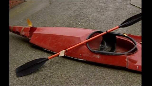 vídeos de stock e filmes b-roll de missing canoeist reappears after 5 years march 2002 county durham hartlepool ext smashed red canoe - condado de durham inglaterra