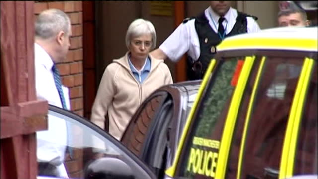 wife of john darwin arrested on suspicion of fraud england county durham hartlepool anne darwin led along to police car car carrying anne darwin... - county durham england stock videos & royalty-free footage