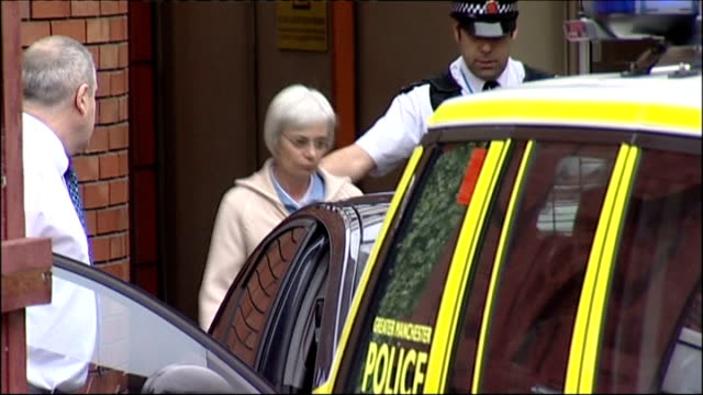 wife of john darwin arrested on suspicion of fraud england manchester airport anne darwin escorted by police officer to car unmarked police car along... - county durham england stock videos & royalty-free footage