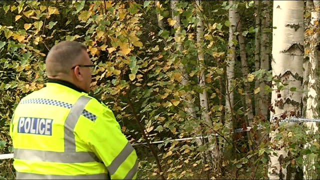 elizabeth kinston: police believe they have found body; england: nottingham: ext various of police officers standing by taped off area of trees where... - postpartum depression stock videos & royalty-free footage