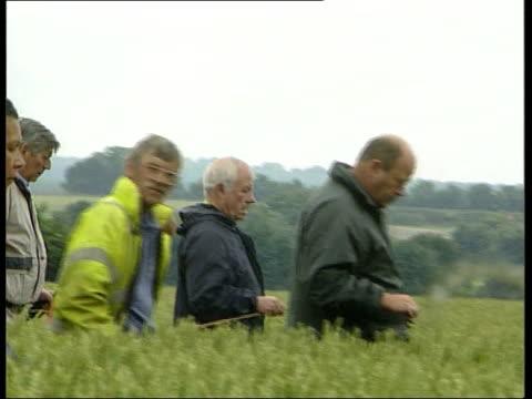 sarah payne:; england: west sussex: littlehampton: ext lms & line of searchers along thru crop field side searchers along thru crop field track... - west sussex stock videos & royalty-free footage