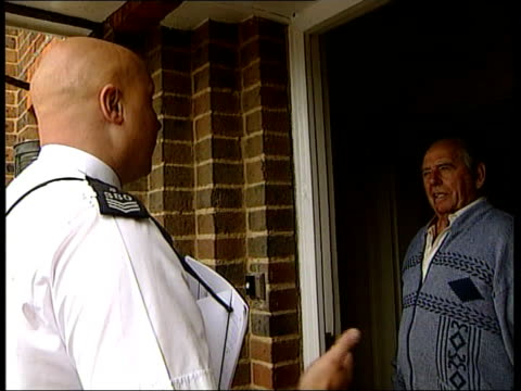 sarah payne police reconstruction england west sussex group of police towards and past down drive of house cbv policeman talking to man on doorstep... - regency style stock videos and b-roll footage